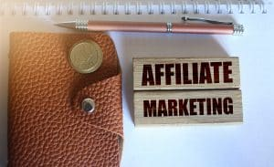 Affiliate Marketing Typed On Wooden Blocks, Wallet, Coins, Pen.