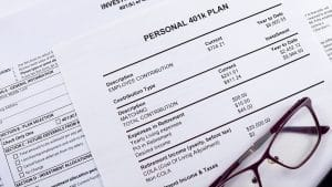 Pension Savings. Glasses And Pen Are On The Background Blank For