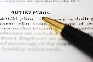 "A pen draws attention to the words ""401(k) Plans"""